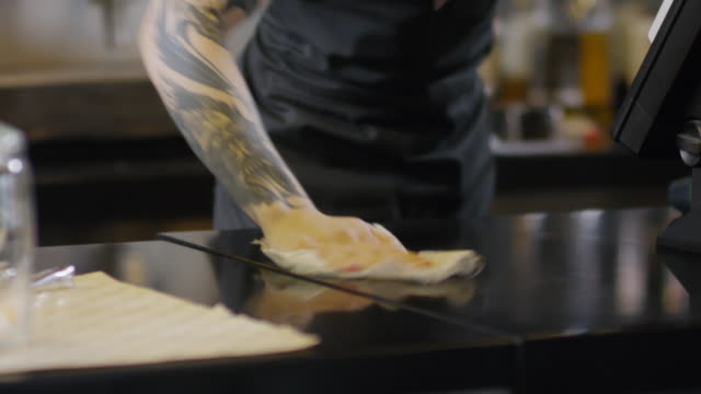 Tattooed Barista Wiping Counter with Cloth - vídeo