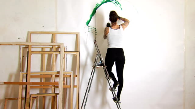 Tattooed Female Artist Painting WS video
