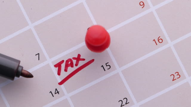 tax day concept with calendar date  and pen