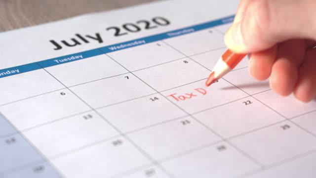 tax day on july 15 - luglio video stock e b–roll