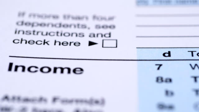 tax form 1040. extreme close up. - politica e governo video stock e b–roll