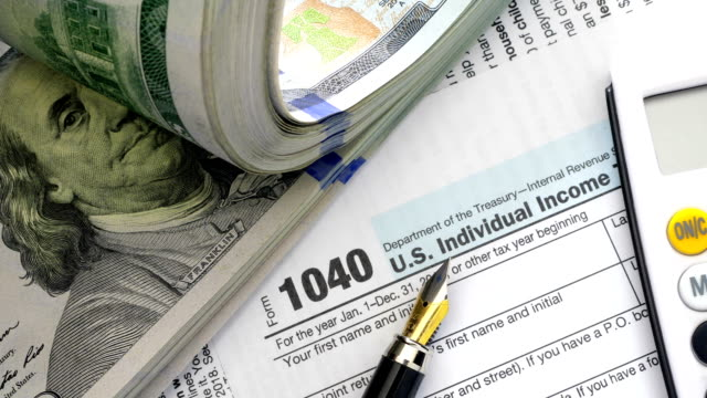 USA tax form with money and pen.