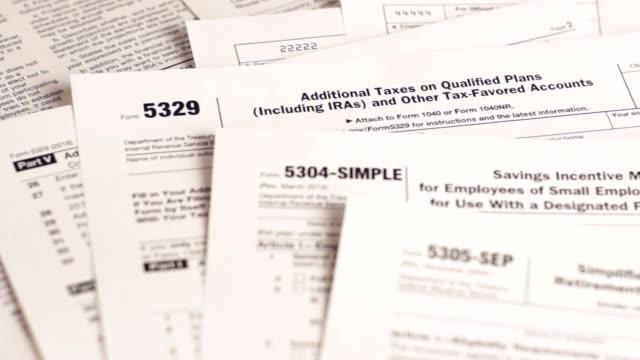 vídeos y material grabado en eventos de stock de formularios de impuestos 5329, 5304, 5305 - plano documento