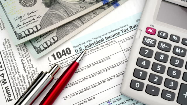 Tax forms with money and pen. video