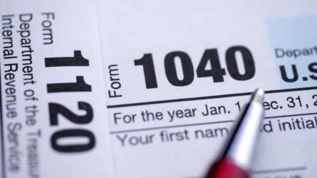 usa tax forms with pen. - zwrot filmów i materiałów b-roll