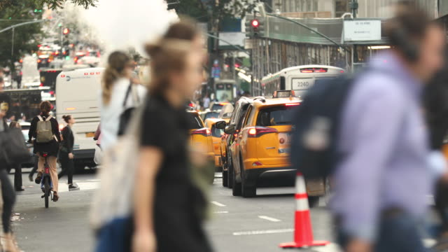 Manhattan, New York - September 19, 2019:  Taxis, bikes and car traffic roll down Broadway at rush hour on the busy streets of downtown Manhattan New York City USA Traffic and yellow cabs of downtown Manhattan New York City USA new york stock videos & royalty-free footage