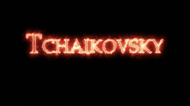 vídeos de stock e filmes b-roll de tchaikovsky written with fire. loop - compositor