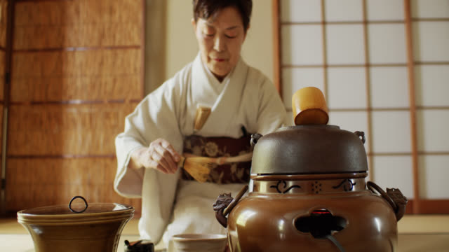 Tea Ceremony Host Rinsing Tea Whisk