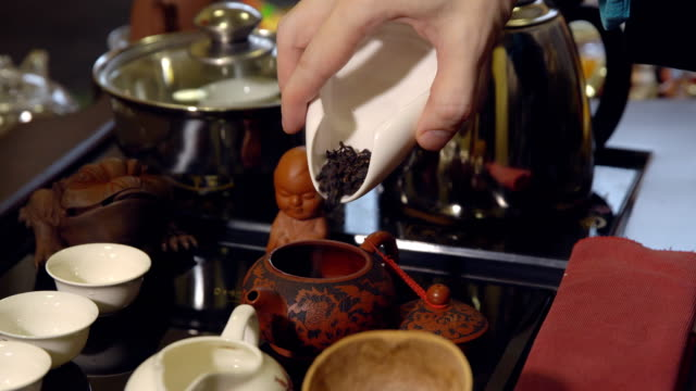 tea ceremony. master pours tea leaves in a teapot - teapot stock videos & royalty-free footage