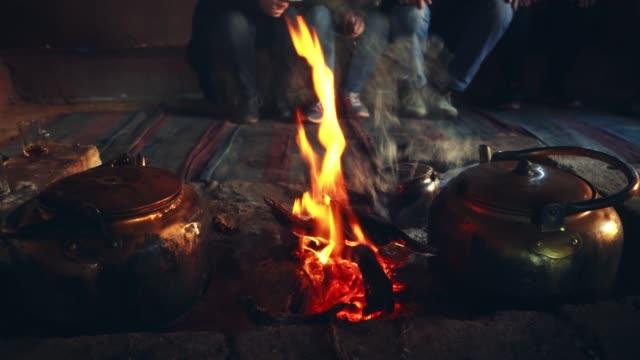 tea kettle on campfire in wadi rum desert  at night - teapot stock videos & royalty-free footage