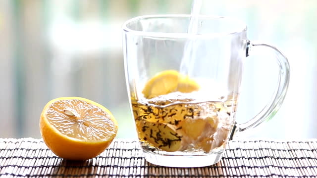 Tea with ginger and lemon. video