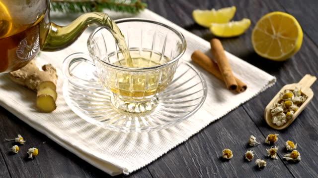 Tea with ginger, lemon. Slow Motion.