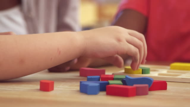 Teacher And Pupils Using Wooden Shapes In Montessori School Teacher And Pupils Using Wooden Shapes In Montessori School child care stock videos & royalty-free footage