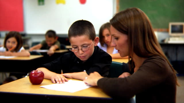 Teacher and student in classroom video