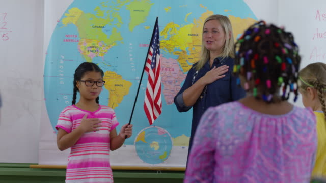 Teacher and student saying pledge of allegiance video