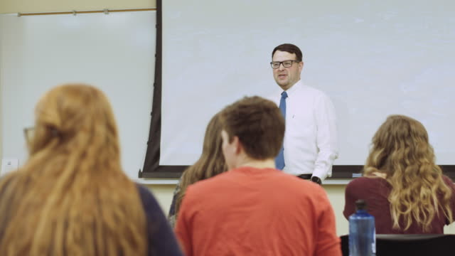 Teacher giving lecture to university students video