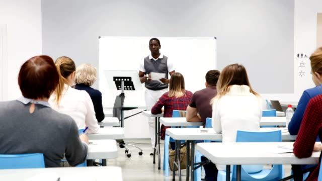 teacher giving presentation for students video
