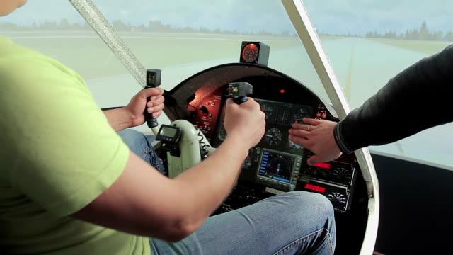 Teacher Helping Aviation School Student Control Steering