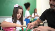 istock Teacher helping special needs student during arts class 1284099571