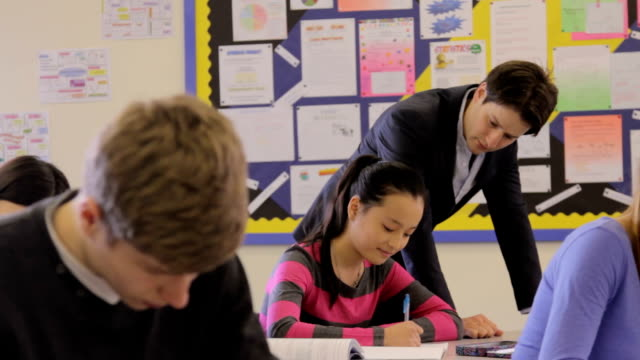 Teacher helps pupil video
