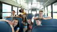 istock Teacher, students, boy with down syndrome on school bus 1208332614