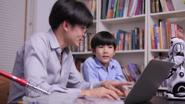 teacher training little boy to learn conputer system at school. technology and education concept. - 8 9 anni video stock e b–roll