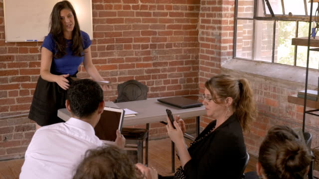 Teacher unable to get the attention of her audience during presentation video
