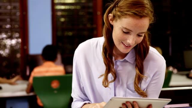 Teacher using digital tablet in classroom video