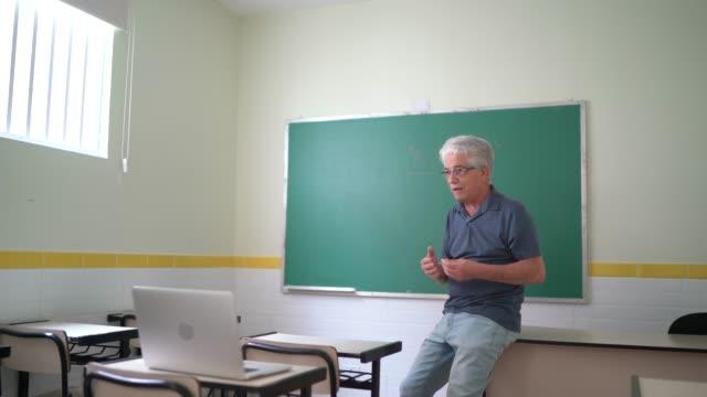 Teacher using laptop to do an online / video class