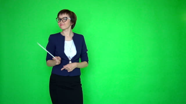 teacher with a pointer dances on green screen background video