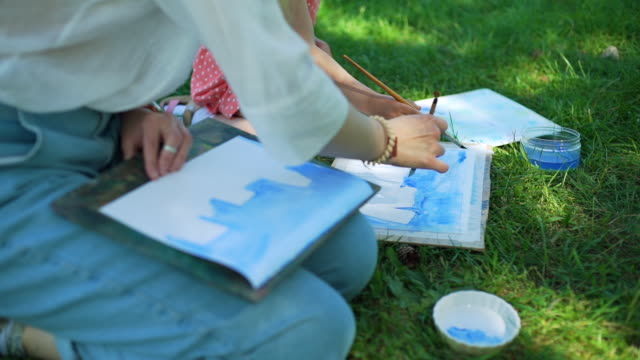 Teacher with Child at Painting Lesson in Nature