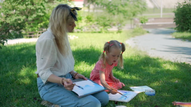 Teacher with Child at Painting Lesson Outdoors