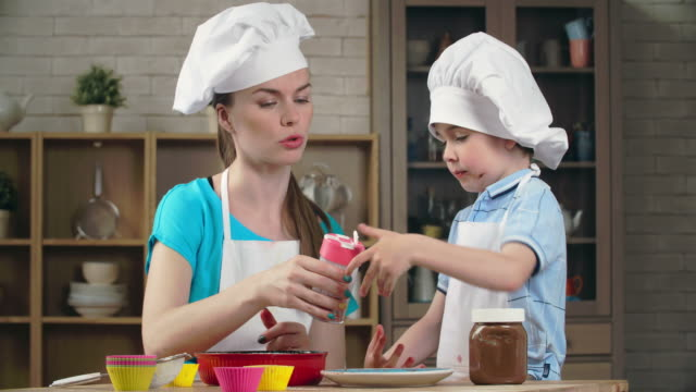 teaching kid to bake - desserts stock videos and b-roll footage