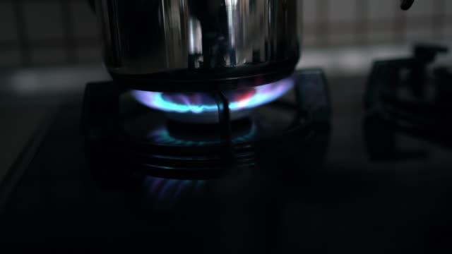 teakettle stove cooker teapot kettle - teiera video stock e b–roll