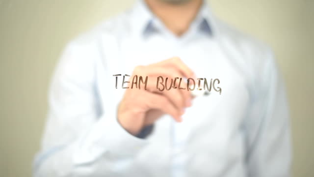 Team Building, Man Writing on Transparent Screen video
