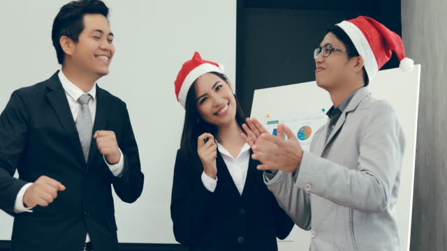 Team Business asian dancing in office video