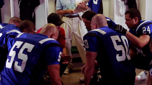 Team huddle in locker room
