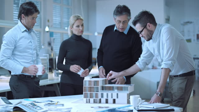 ds team of architects brainstorming around the model - architect stock videos and b-roll footage