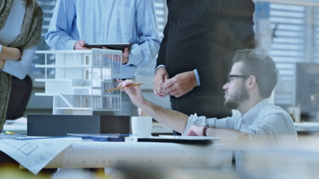 Video DS Team of architects defining detail of architectural model