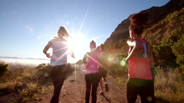 Team of athletes running outdoors on summer video