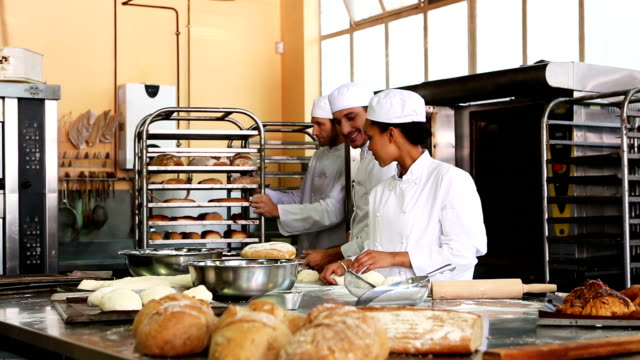 team of bakers working together - busy restaurant kitchen stock videos & royalty-free footage