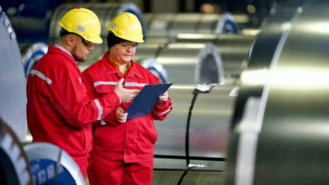 Team of engineers having discussion on industrial steel plant Team of engineers having discussion on industrial steel plant. occupational safety and health stock videos & royalty-free footage
