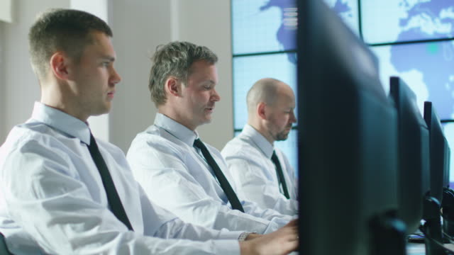 Team of IT Professionals Working at the Computers in Bright Office. video