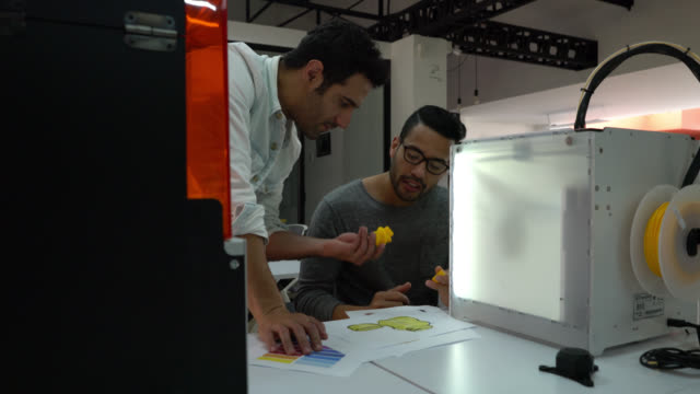 team of male designers working on a plastic container design with the 3d printer - designers video stock e b–roll