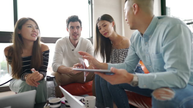 Team of millennials brainstorming in the apartment video