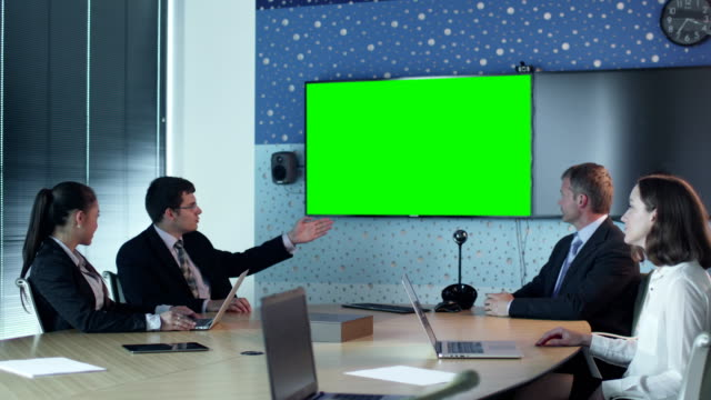 Team Of Office Workers Have Conversation in Conference Room. Display with Green Screen for Mockup on Wall. video