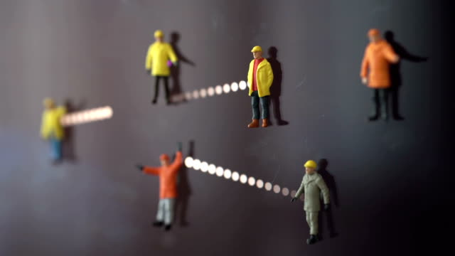 Team of workers network - real figures, computer animation background. video