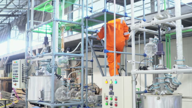 Team of workers walking and discussi in fuel plan Industrial background Team of workers walking and discussi in fuel plan Industrial background biofuel stock videos & royalty-free footage