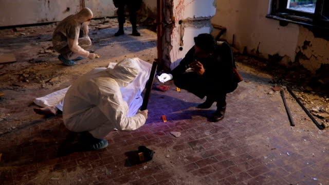 Teamwork at murder scene Group of people at the crime scene, detective, forensics and special forces next to a dead body. crime scene stock videos & royalty-free footage