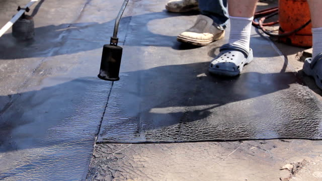 Teamwork at roofing installation resin video